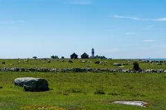 Far away view of the lighthouse tall Jan. Minimalistic view of the the lighthouse tall Jan at the south end of the island Öland outside the Swedish east coast Stock Photography