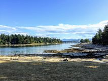 A far away view of Nanaimo, British Columbia, Canada from the be. Autiful shores of Newcastle Island royalty free stock photography