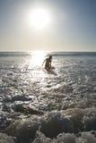 Far bather woman against sun Royalty Free Stock Photos