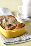 Far breton. A custard pudding cake from Brittany, France. Baked with prunes in a small yellow baking dish Royalty Free Stock Photo