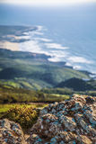 Far. Coastline with near object focus, Sintra Mountain, Portugal Royalty Free Stock Image