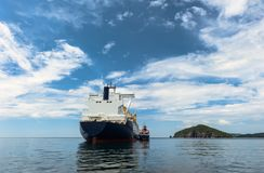 A small tanker on the roadstead bunkers a large LNG tanker. stock image