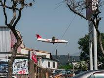 Far Eastern Air Transport small airplane ATR 72-600 landing at Taipei Songshan Airport in Taiwan. TAIPEI, TAIWAN - March 12, 2019: Far Eastern Air Transport stock images
