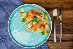 Far Eastern deep-sea perch, stewed in coconut milk and root vegetables confit. European cuisine. The work of a professional chef. stock photo