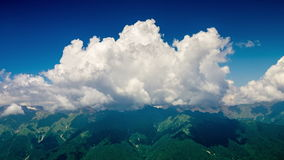 Far Mountain And Clouds Time Lapse 4K. Far mountain and fast clouds time lapse 4k stock footage