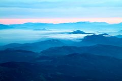Far mountains with blue haze and clouds. Sunset or sunset Stock Photo