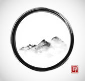 Far mountains in fog in black enso zen circle. Traditional oriental ink painting sumi-e, u-sin, go-hua. Hieroglyph - zen.  Royalty Free Stock Image