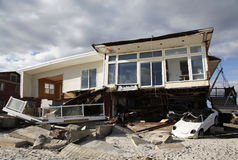 Destroyed car and beach house in the aftermath of Hurricane Sandy in Far Rockaway, NY Royalty Free Stock Photos
