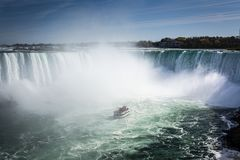 Ship in the mist of Niagara Falls waterfall royalty free stock images