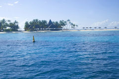 A far shoot of a beach with blue reef in a island Royalty Free Stock Images