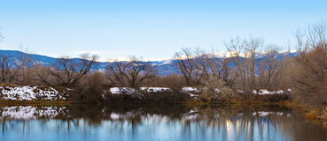Far Shore of a Lake with View of Distant Mountains Royalty Free Stock Photos
