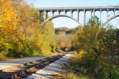 Far train under bridge stock photo