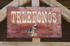Far west telephone sign in spanish Stock Images