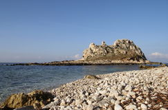 Faraglione beach. The beach and the cliff in Levanzo Egadi islands - Sicily Royalty Free Stock Photos