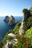 The Faraglioni. The massive outcroppings of rock called the Faraglioni in Capri off the coast of Naples, Italy, is said to be the boulders that the Cyclops threw Royalty Free Stock Photo