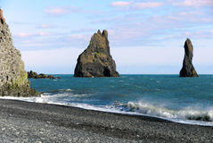 Faraglioni on the beach of organ pipes. Faraglioni of organ pipes on the beach at Vik in Southern Iceland Stock Photography