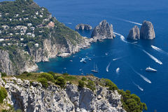 Faraglioni and cristal water in capri, summertime stock photos