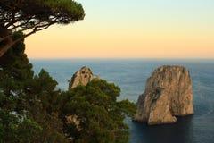 Faraglioni at Dusk. The Faraglioni illuminated by the late afternoon sun in Capri stock photos