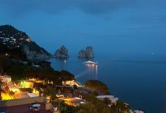 Faraglioni by night, famous giant rocks, Capri island. In Italy stock image