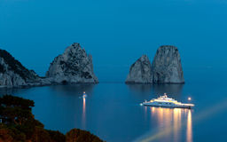 Faraglioni by night, famous giant rocks, Capri island Royalty Free Stock Image