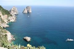 Faraglioni rock formations. Capri coastline with view of Faraglioni rock formations Royalty Free Stock Images