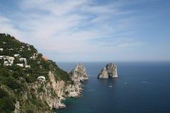 Faraglioni rock formations. Capri coastline with view of Faraglioni rock formations Royalty Free Stock Photo