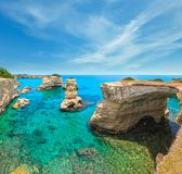 Faraglioni at Torre Sant Andrea, Italy. Picturesque seascape with cliffs, rocky arch and stacks faraglioni, at Torre Sant Andrea, Salento sea coast, Puglia stock image