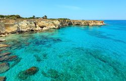Faraglioni at Torre Sant Andrea, Italy. Picturesque seascape with cliffs, rocky arch and stacks faraglioni, at Torre Sant Andrea, Salento sea coast, Puglia Royalty Free Stock Photography
