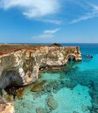 Faraglioni at Torre Sant Andrea, Italy. Picturesque seascape with cliffs, rocky arch at Torre Sant Andrea, Salento sea coast, Puglia, Italy. Two shots stitch Stock Image