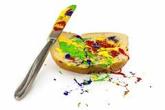 Farba rozprzestrzeniająca na chlebie Zdjęcia Royalty Free
