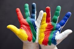 Farbe gemalte Kinderhand Lizenzfreies Stockbild