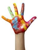Farbe gemalte Kindhand Lizenzfreies Stockfoto