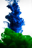 Farbe im Wasser, Rot, bunt, blau, grün, Gelb Stockbild