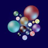 Farbe von Perlenproben auf dunkelblauem Hintergrund Lizenzfreies Stockfoto