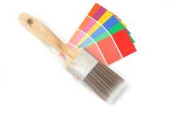 Farbenanleitung und Pinsel 1 Stockfotos