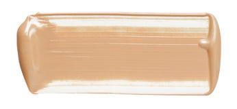 Farbenanschläge der flüssigen Grundierung lokalisiert auf weißer Kosmetik Abstrichanschlag Lizenzfreie Stockfotografie