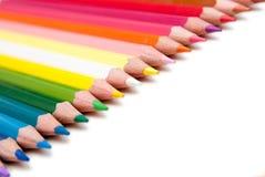 Farbenbleistifte auf dem weißen Hintergrund Stockbild