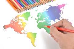 Farbenbleistifte und Weltkarte Lizenzfreies Stockbild