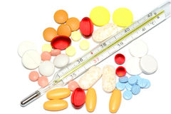 Farbenpillen mit Thermometer Stockbilder
