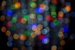 Farbgirlanden-Kranzhintergrund, unfocused Stockfotografie