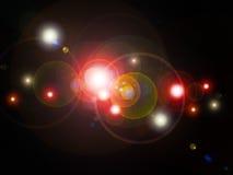 Farbhelle Punkte auf schwarzem Hintergrund Stockfotografie
