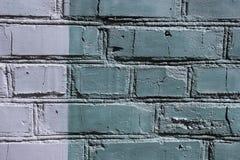 Farbige Backsteinmauer in der grauen Farbe Stockfotos