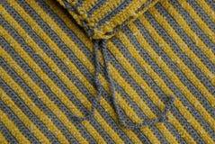 Farbige Beschaffenheit eines Stückes des woolen Stoffes Stockfotografie