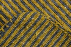 Farbige Beschaffenheit eines Stückes des woolen Stoffes Lizenzfreie Stockfotos