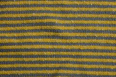 Farbige Beschaffenheit eines Stückes des woolen Stoffes Stockbilder