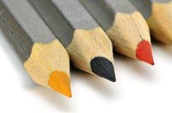 Farbige Bleistifte auf einem weißen Hintergrund Stockbild