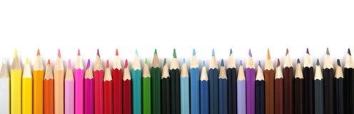 Farbige Bleistifte auf einem weißen Hintergrund Panorama Lizenzfreie Stockfotos