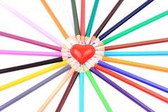 Farbige Bleistifte um Inneres Lizenzfreie Stockfotos