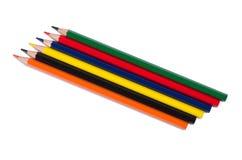 Farbige Bleistifte und ein Notizbuch Lizenzfreies Stockbild
