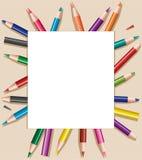 Farbige Bleistifte unter Blatt Papier Lizenzfreie Stockfotografie